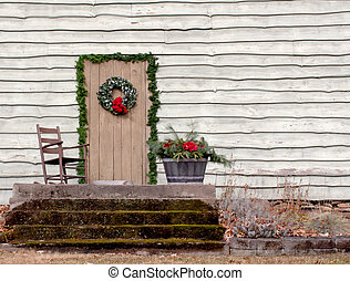 Rocking Chair On Porch - A wooden rocking chair on a porch...