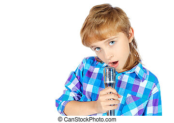 microphone - Portrait of a cute boy singing with microphone....