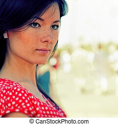 Beauty young girl portrait with unfocused backgrounds