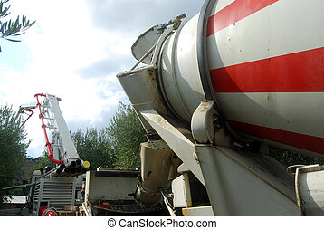 A cement mixer full of concrete pump - A huge machine with...