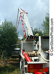 A concrete pump truck in action - A huge machine with...