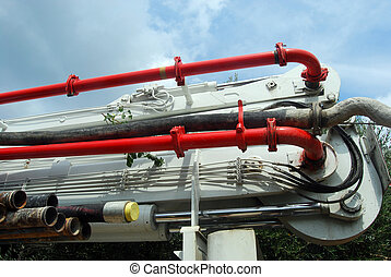 Articulated arm and distribution pipes - A huge machine with...