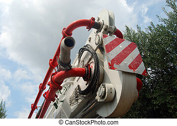 Articulated arm of a pump truck - A huge machine with...