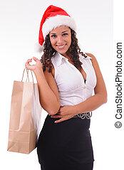 beautiful woman shopping for Christmas
