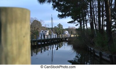 boat dock - A quiet, still boat dock with glassy water.