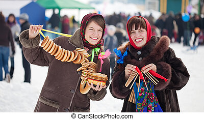 girls celebrating Shrovetide - Two happy girls celebrating...
