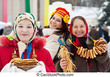 Young girl with pancake during  Shrovetide at Russia