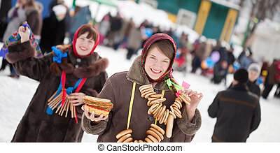 Girl with pancake during Maslenitsa festival - Girl in...