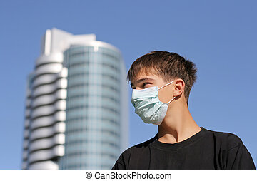 Teenager in Flu Mask - Serious Teenager in the Flu Mask on...