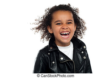Profile shot of an elementary kid laughing heartily