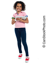 Primary child with a tablet pc smiling cheerfully Indoor...