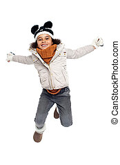 Excited primary girl jumping with joy