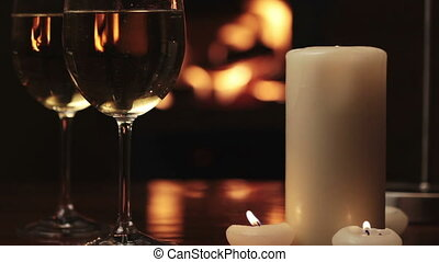 Glasses of champagne near fireplace