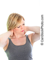 Woman with neck pain stretching her muscles standing with...