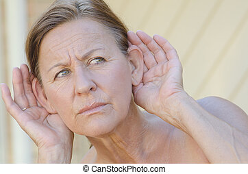 Woman hand to ear listening isolated outdoor III - Portrait...
