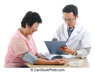 asian senior female medical checkup with doctor ,south east...