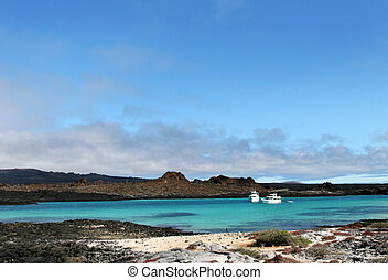 Galapagos Island Beach - Two yachts wait offshore for...