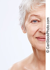 Elderly woman on a white background