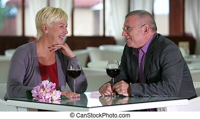 Senior romance - Romantic senior couple enjoying wine at...