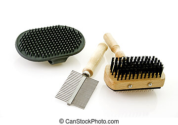Dog brushing tools on bright background