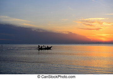 Silhouette fisherman are taking fishing boat