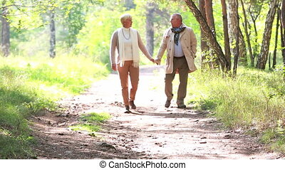 Late summer walk - Charming seniors taking an unhurried walk...