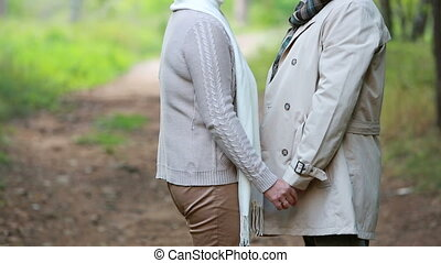Love confession - Happy senior woman holding hands with her...