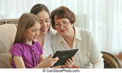 Modern device - Granddaughters showing to their grandma how...