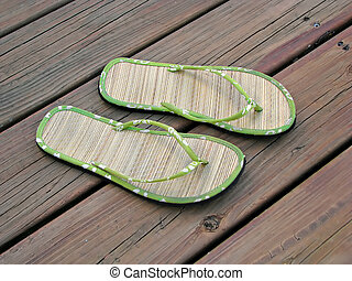 sandals - pair of summer sandals on wood deck