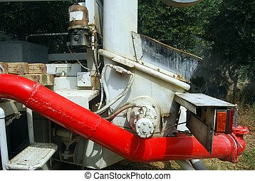 Tank pumping concrete pump truck - A huge machine with...