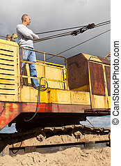 tractor operator at sand pit - Portrait of tractor operator...