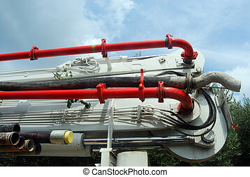 The tubes of a pump truck - A huge machine with articulated...