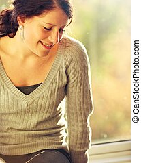 Young Woman Looking Down and Thinking of a Happy Thought -...