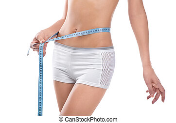 Woman measuring waist of perfect body by centimeter
