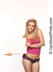 Woman in lingerie with a blank board