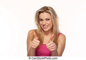 Beautiful blonde giving a thumbs up gesture