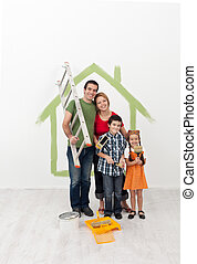 Family painting their home - with the kids helping