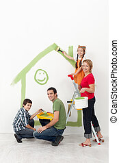 Family with kids painting their home