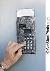 uses intercom in door - Close-up of uses intercom in steel...