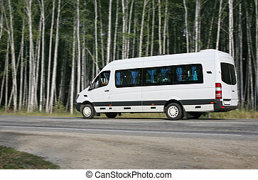 minibus goes on the forest road - white minibus goes on the...