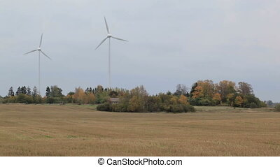 Two wind turbines in the field Green energy