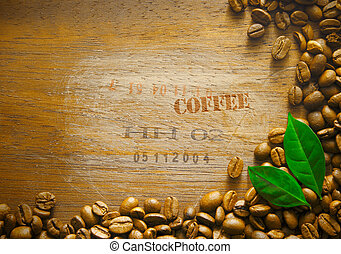 Coffee bean background border on a textured wooden surface...