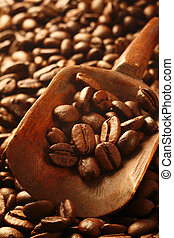 Fresh coffee beans, a valuable commodity - Background of...