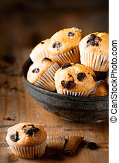 Fresh mini muffins on aged wood background - A single mini...