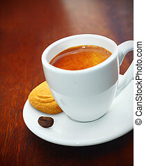 Espresso coffee served with a biscuit - Cup of freshly...
