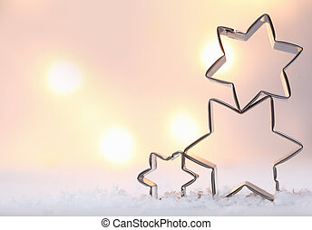 Atmospheric Christmas star background with three metal star...