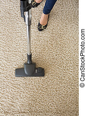 Carpet being hoovered by woman - Cream carpet being hoovered...