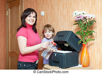 mother and daughter uses humidifier at home
