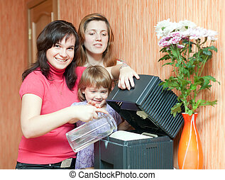women and girl uses humidifier - Two women and girl uses...