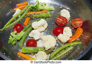 Cooking vegetables in a pan - cook fresh vegetables in a pan...